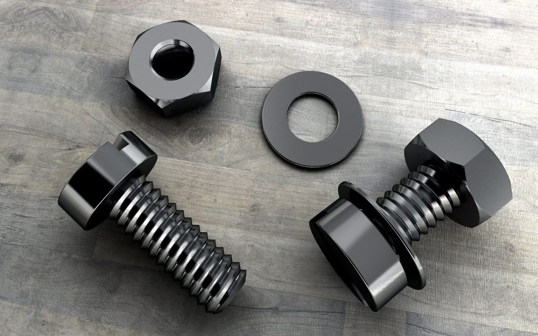 nuts and bolts lying on a wooden table